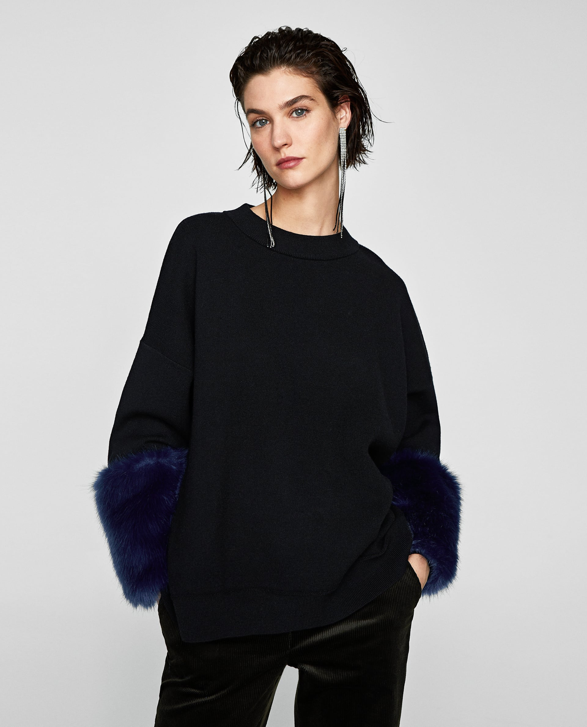 COMBINED OVERSIZED SWEATER WITH FAUX FUR TRIMS