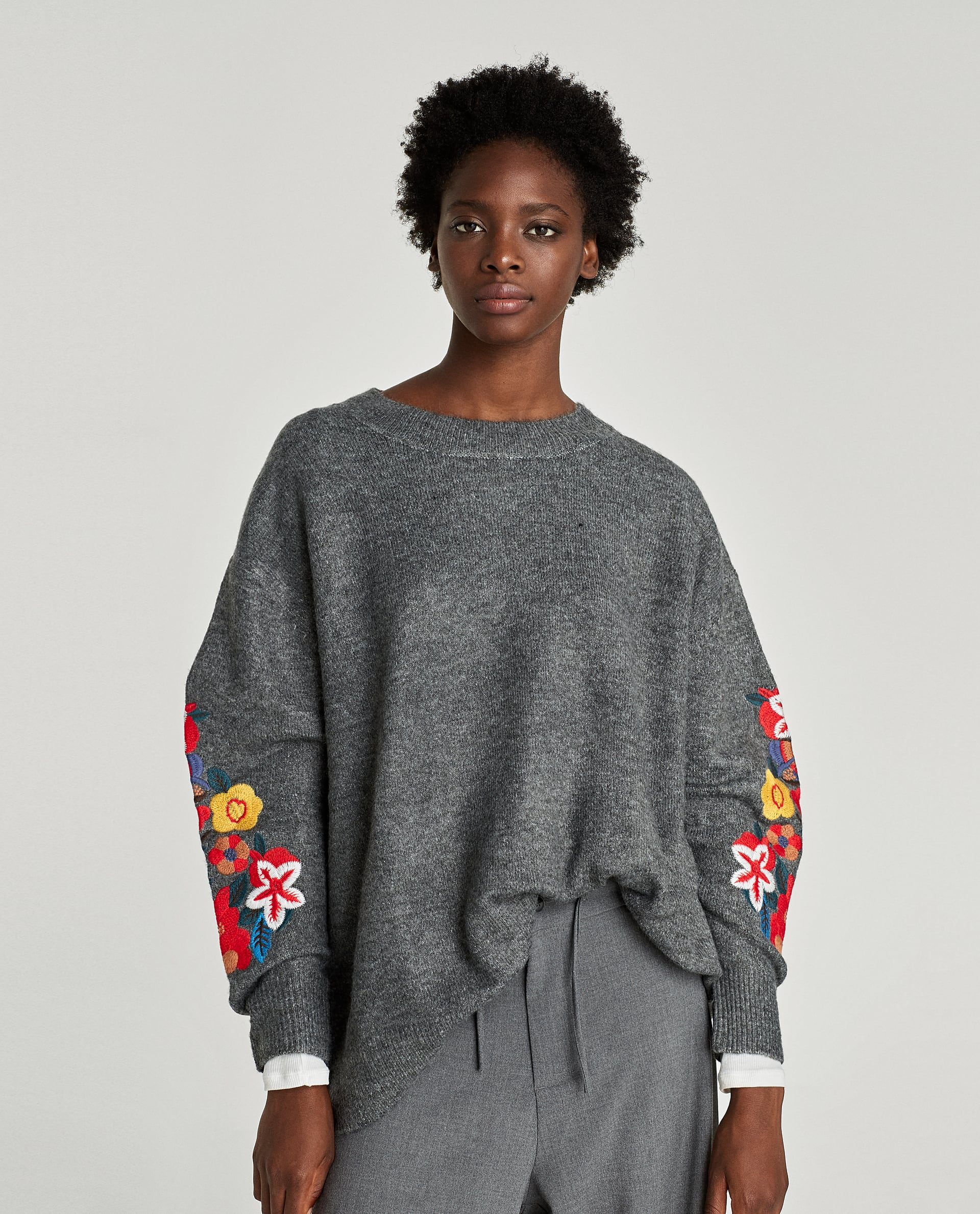 EMBROIDERED OVERSIZED SWEATER WITH CUFF DETAIL