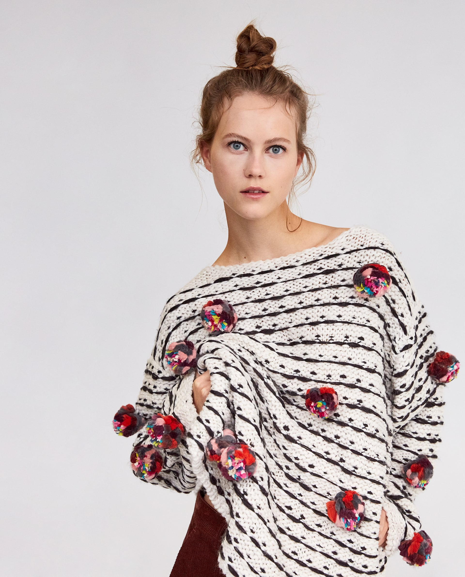 SWEATER WITH COLORED POMPOMS